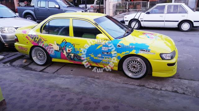 (マレーシア)痛車ボーカロイド初音ミク仕様!E100型カローラ4ドア&4AGZE換装6速MT!AE101カローラ中古車