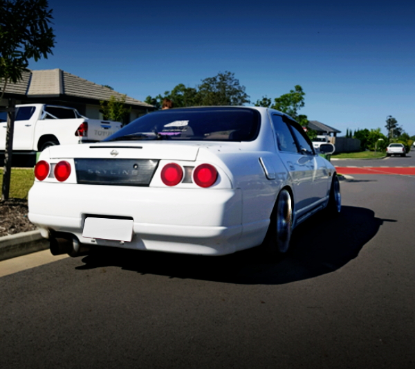 REAR EXTERIOR R33 SKYLINE 4-DOOR WHITE