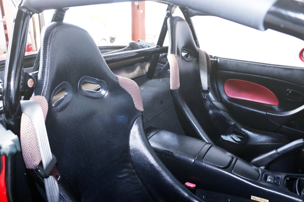FULL BUCKET SEATS AND ROLL CAGE