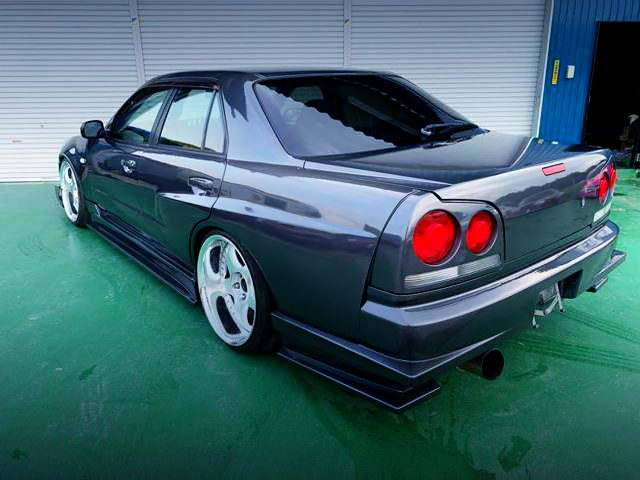 REAR EXTERIOR OF R34 SKYLINE 4-DOOR WITH URAS WIDEBODY