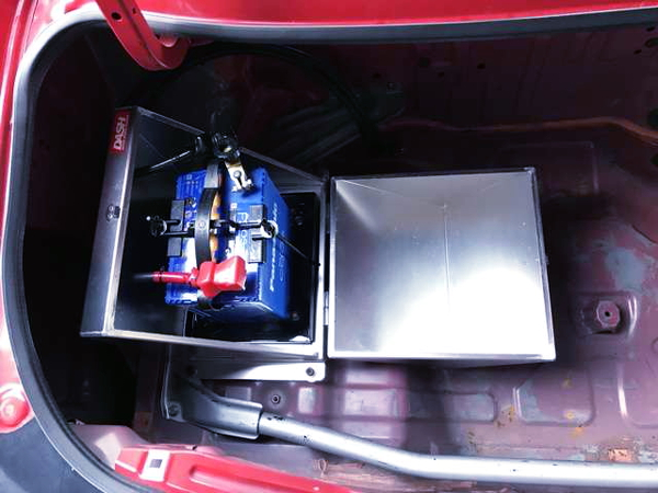 BATTERY RELOCATION AT TRUNK