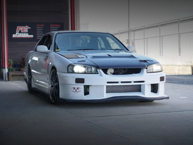 FRONT EXTERIOR OF R34 SKYLINE 4-DOOR TO WHITE