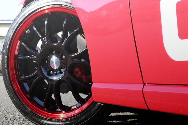 RED RIM AND BLACK WHEEL
