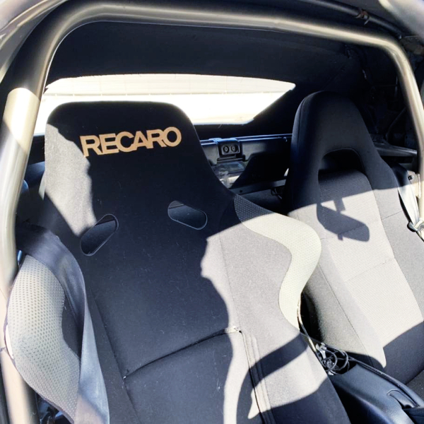 RECARO SEAT AND HALF ROLL BAR