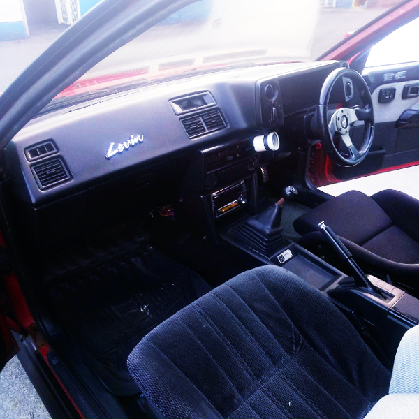 INTERIOR OF AE86 DASHBOARD AND LEVIN EMBLEM