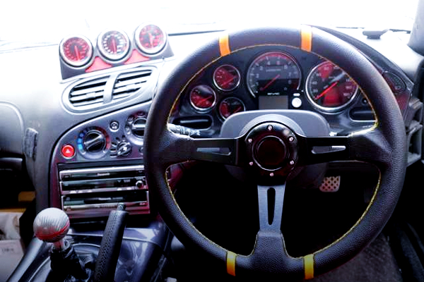 INTERIOR OF DRIVER'S GAUGES AND STEERING