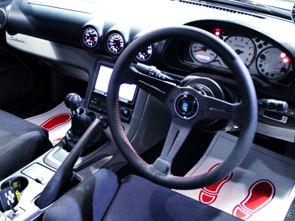 INTERIOR OF S15 DASHBOARD AND NARDI STEERING.
