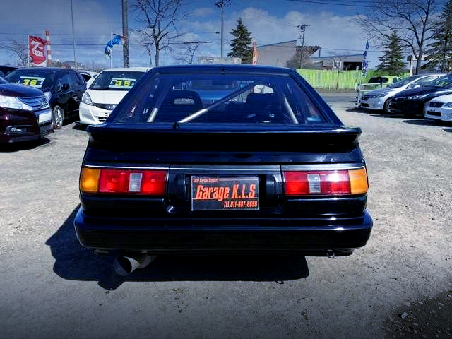 REAR EXTERIOR OF AE86 LEVIN HATCH TO BLACK PAINT.