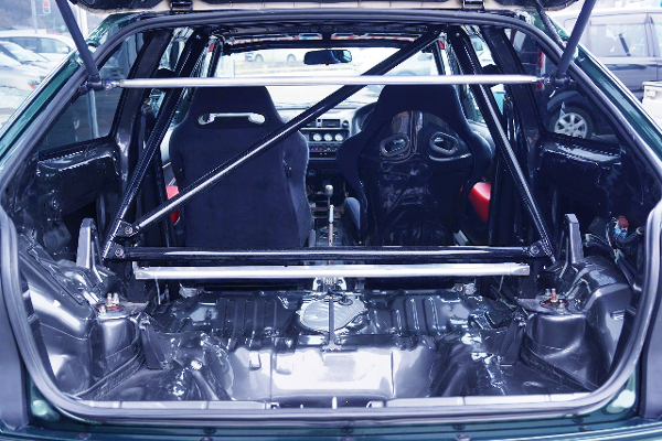 INTERIOR OF TWO SEATER AND ROLL CAGE.
