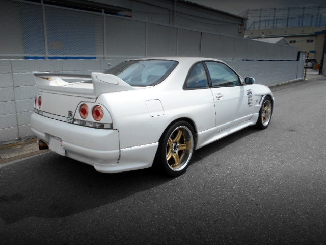 REAR EXTERIOR OF R33 GT-R White.