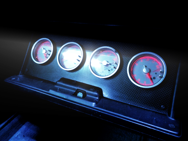 GAUGES INSTALLED TO GLOVE COMPARTMENT.