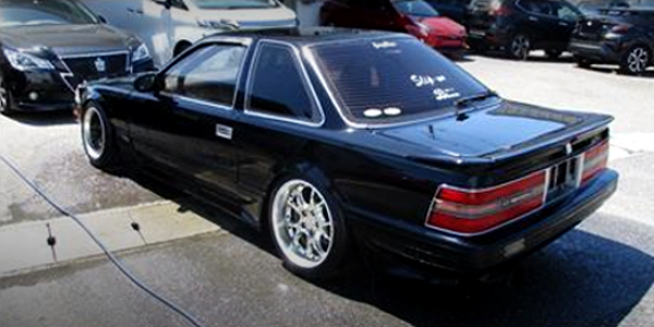 REAR EXTERIOR OF Z20 SOARER BLACK.