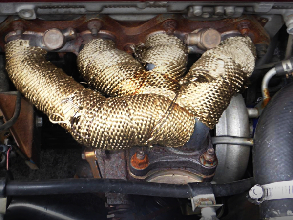 EXHAUST MANIFOLD ON 4G63 MIVEC TURBO ENGINE.