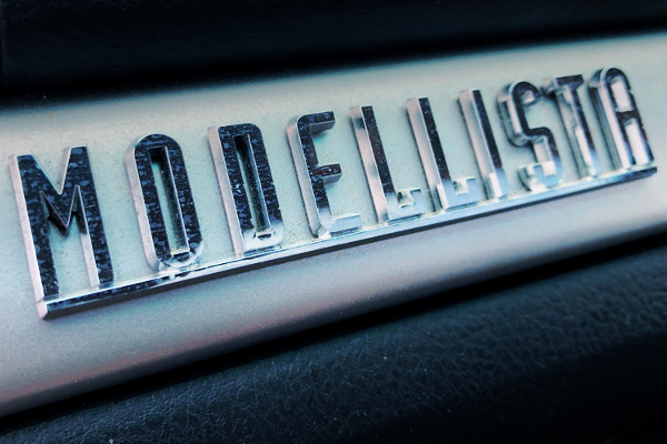 MODELLISTA EMBLEM ONTO INTERIOR DASHBOARD.