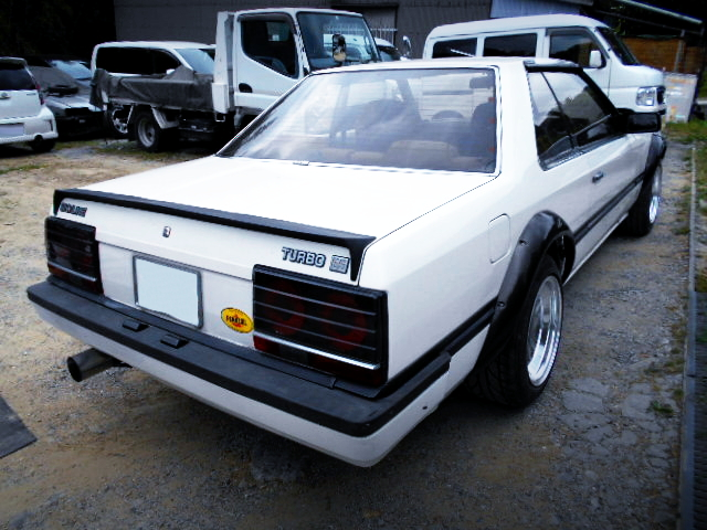 REAR EXTERIOR OF R30 SKYLINE 2-DOOR WHITE.