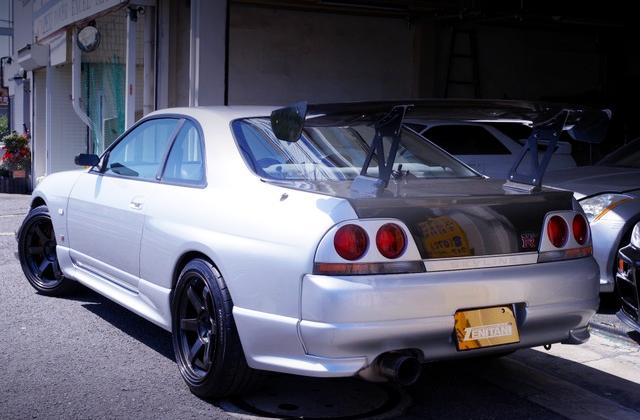 REAR EXTERIOR OF R33 GT-R SILVER.