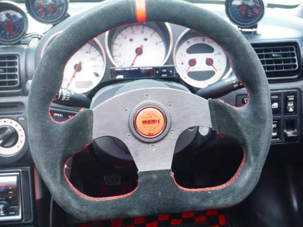 SPORT STEERING AND SPEED CLUSTER.