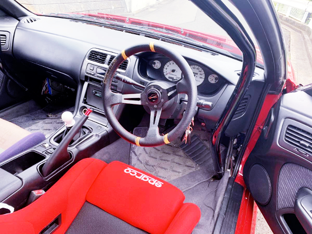 SPEEDOMETER CLUSTER AND ROLL CAGE OF S14 SILVIA INTERIOR.