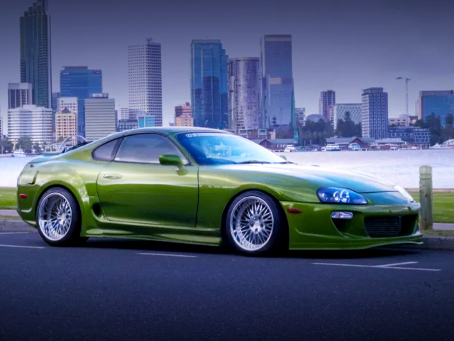 FRONT EXTERIOR OF JZA80 SUPRA With RIDOX WIDEBODY AND GREEN PAINT.