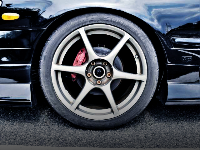 FRONT 4-POT CALIPER AND R34GT-R WHEEL.