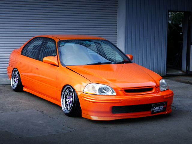 FRONT EXTERIOR OF EK4 CIVIC FERIO Si2 ORANGE.