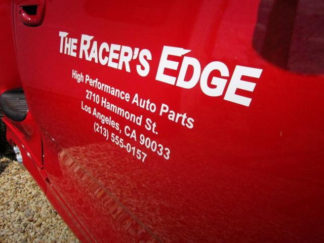 THE RACER'S EDGE REPLICA LOGO.
