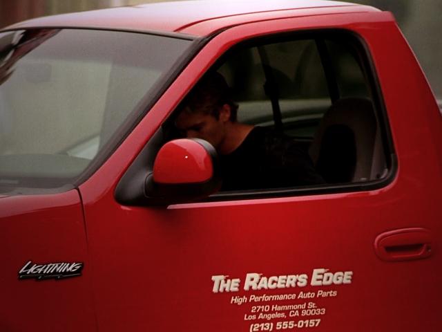THE RACER'S EDGE LOGO.