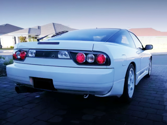 REAR EXTERIOR OF 180SX PEARL WHITE.