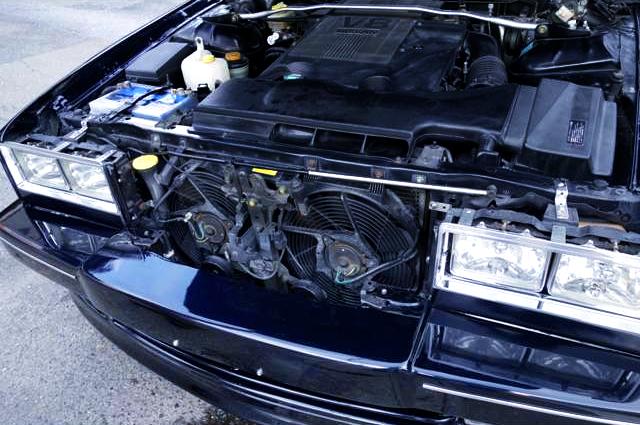 HOOD OPEN TO VH41DE V8 ENGINE.