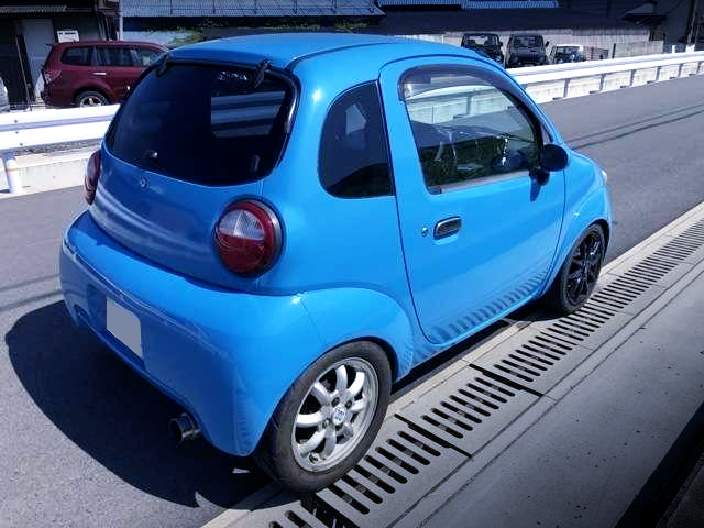 REAR EXTERIOR OF SUZUKI TWIN With LIGHT BLUE PAINT.