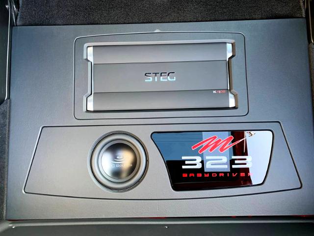 AUDIO SYSTEM AND MAZDA 323 LOGO.