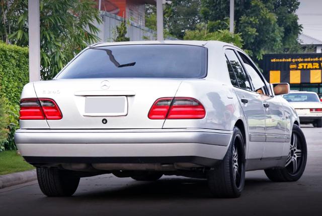 REAR EXTERIOR OF W210 MERCEDES BENZ E240 SILVER.