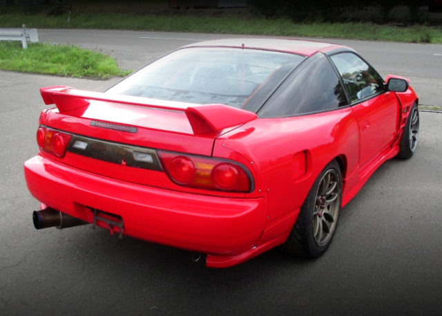 REAR EXTERIOR OF 180SX TYPE-X RED.