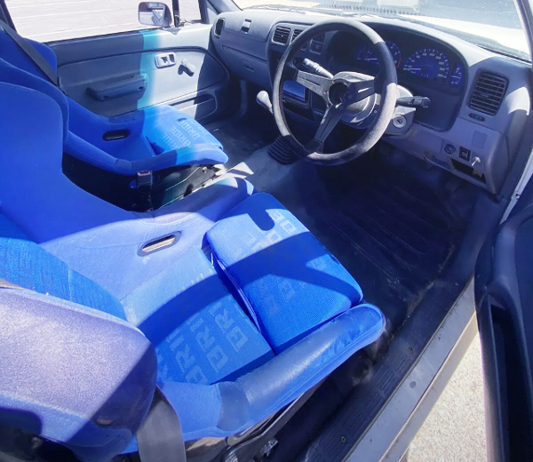 BUCKET SEATS AND SPORT STEERING.