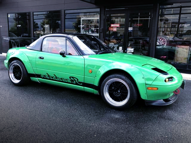 RIGHT-SIDE EXTERIOR OF NA8C ROADSTER TO GREEN.