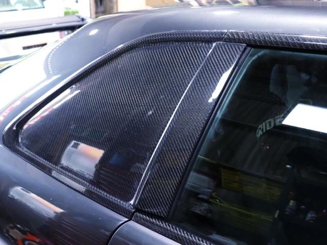 REAR SIDE CARBON WINDOW PANEL OF R34 SKYLINE.