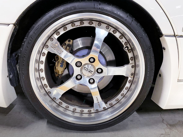 REAR ALCON BRAKE CALIPER.