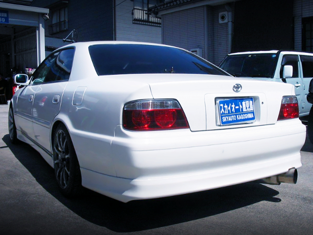 REAR EXTERIOR OF 100 CHASER TO WHITE.