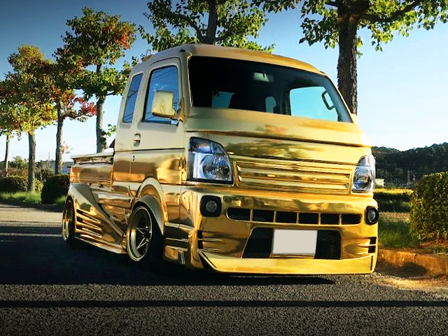 FRONT EXTERIOR DA16T SUPER CARRY WIDEBODY AND GOLD.