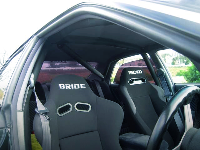 ROLL BAR AND BACKET SEATS.