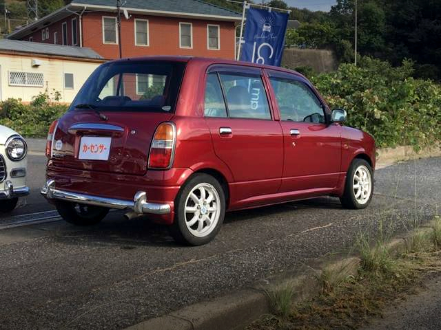 REAR EXTERIOR OF 1st Gen MIRA GINO TO WINE RED.