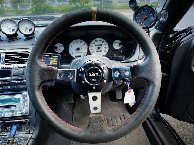 SPEED CLUSTER AND AFTERMARKET STEERING.