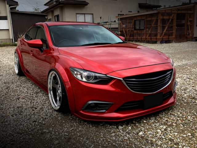 FRONT EXTERIOR OF GJ ATENZA SEDAN XD TO SOUL RED CRYSTAL.