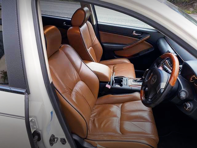 INTERIOR BROWN LEATHER SEATS.