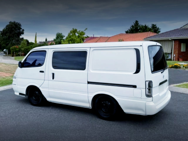 REAR EXTERIOR OF H100 TOYOTA HIACE WHITE.