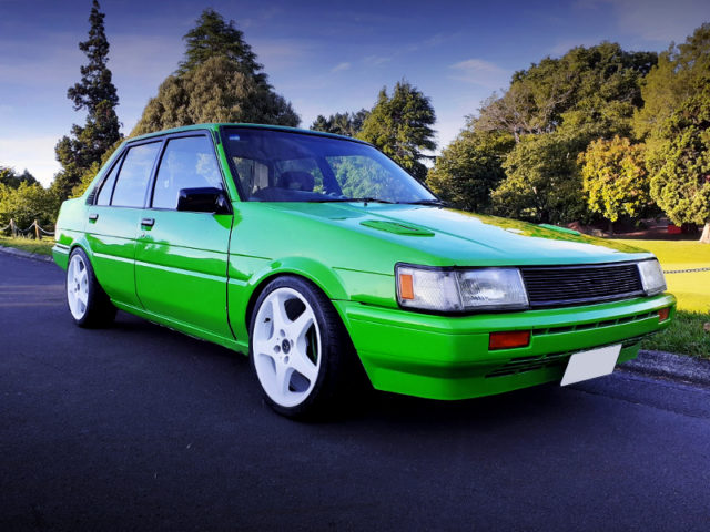 FRONT EXTERIOR OF AE82 COROLLA SEDAN TO GREEN PAINT.