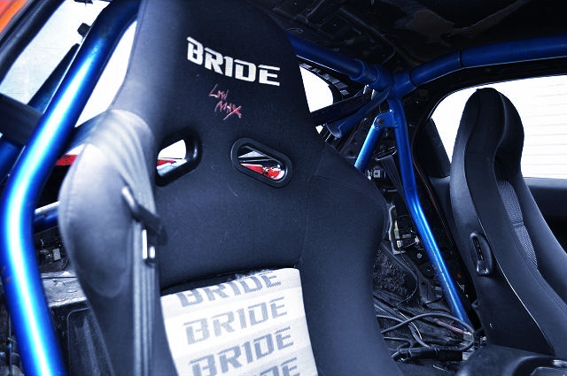 BRIDE FULL BUCKET SEAT And ROLL BAR.