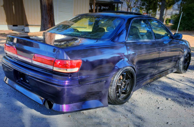 REAR EXTERIOR OF JZX100 MARK2 PURPLE.