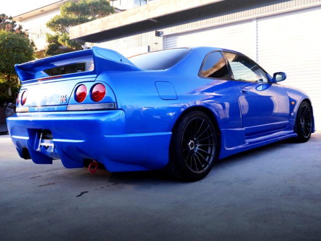 REAR EXTERIOR OF R33 GT-R V-SPEC BAYSIDE BLUE.
