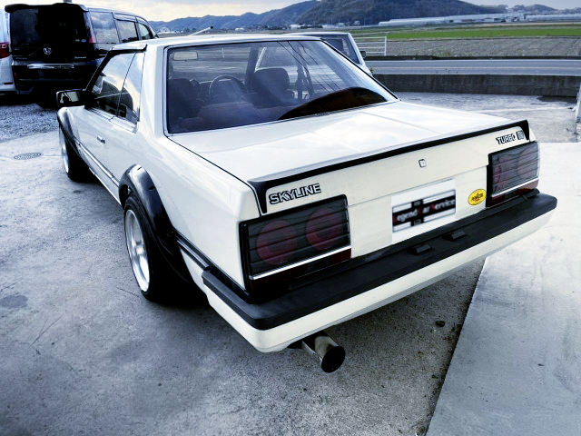 REAR EXTERIOR OF HR30 SKYLINE 4-DOOR TO WHITE.